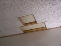 Cardboard ceiling with three tiles missing